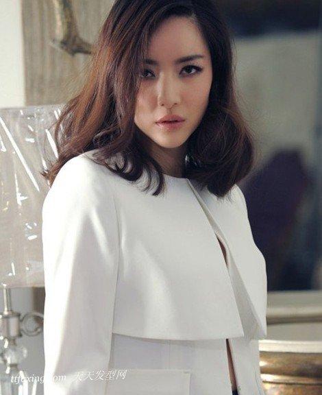引起时尚热潮—陶瓷烫卷发发型 zaoxingkong.com